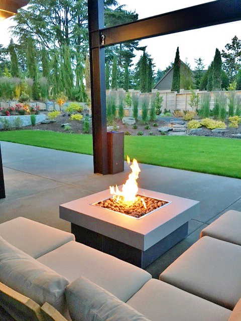Fire Table with Seating on Back Patio - Sunset Outdoor Living